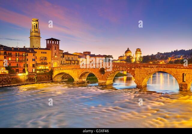 Verona - Ponte Pietra Bridge at evening dusk, Italy - Stock Image