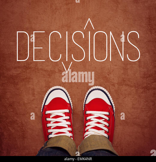 Youth Decision Making Concept, Feet in Red Sneakers from Above Standing at Ground with Decisons Title Printed, Top - Stock Image