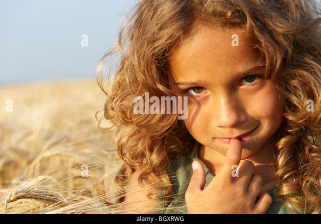 Girl in a wheat field - Stock Image