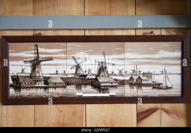 Windmills tiles painted from Zaanse Schans, Netherlands, Europe - Stock Image