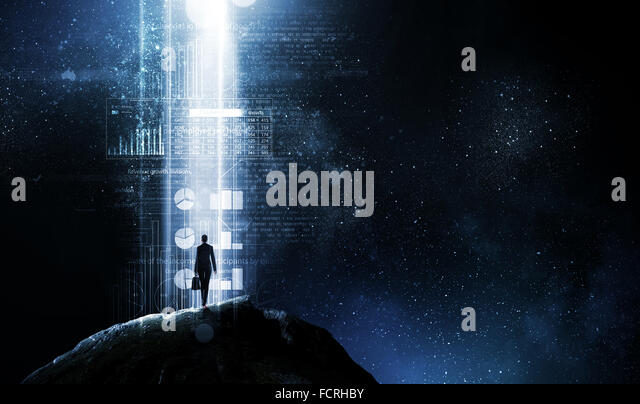 Rear view of businesswoman standing in light of way - Stock Image