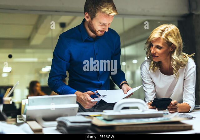 Man and women workshop design in action - Stock Image