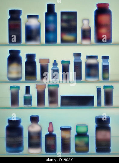 Medicine bottles in cabinet - Stock Image