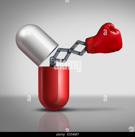 Medicine power medical concept as an open three dimensional prescription capsule pill or vitamin with a boxing glove - Stock Image