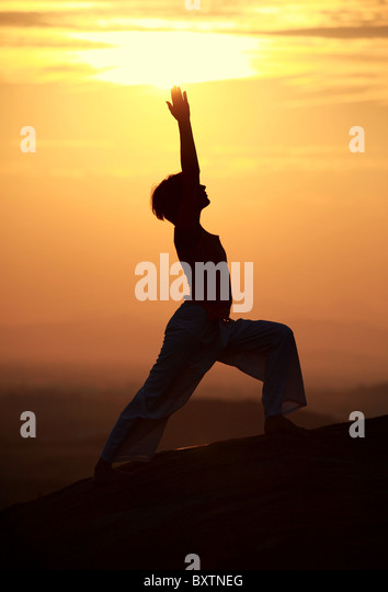 Foreigner woman doing hatha yoga on the rocks Andhra Pradesh South India - Stock-Bilder