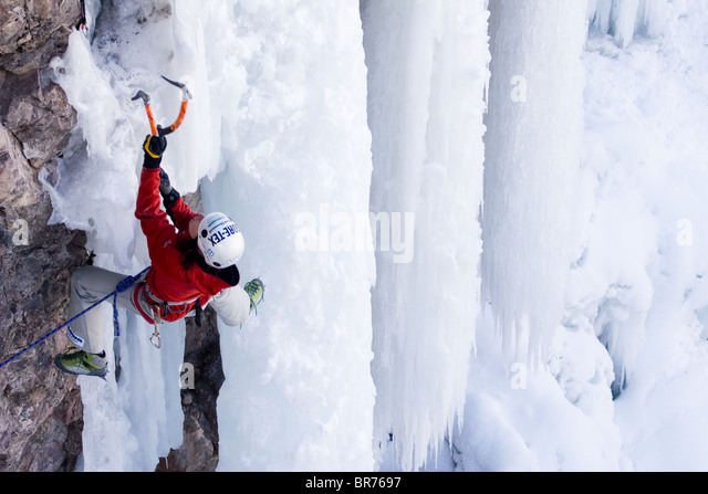 Woman ice climbing Colorado - Stock-Bilder