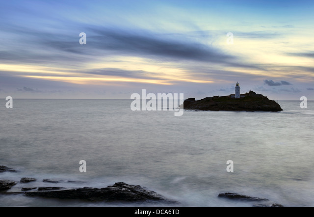 Dusk at Godrevy Lighthouse near St Ives in Cornwall - Stock Image