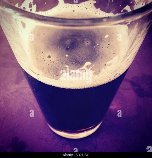Dark beer in glass - Stock-Bilder