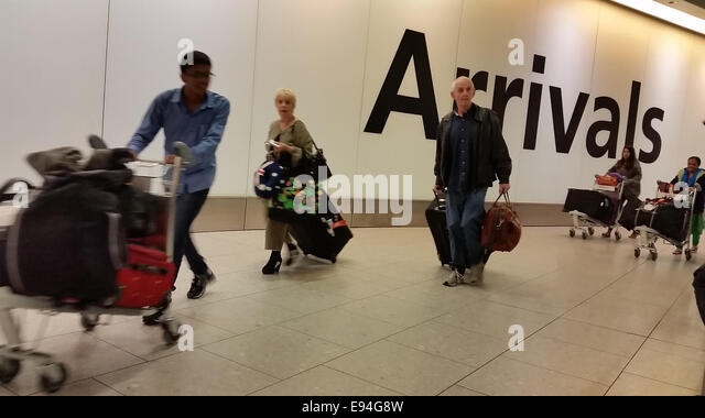 London, UK - 19 October 2014. Passengers arriving at Heathrow Terminal 4 one of the airports due to screen passengers - Stock Image