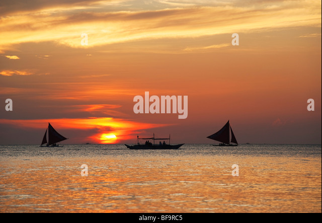 Sail boats at sunset Boracay; The Visayas; Philippines. - Stock Image