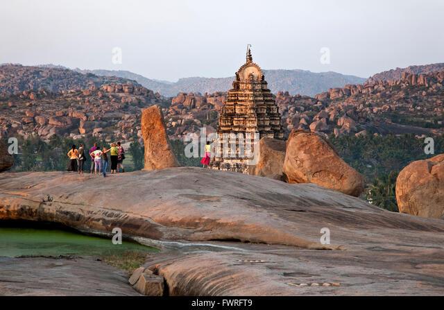 Tourists contemplating the Virupaksha temple. Hampi. Karnataka. India - Stock Image