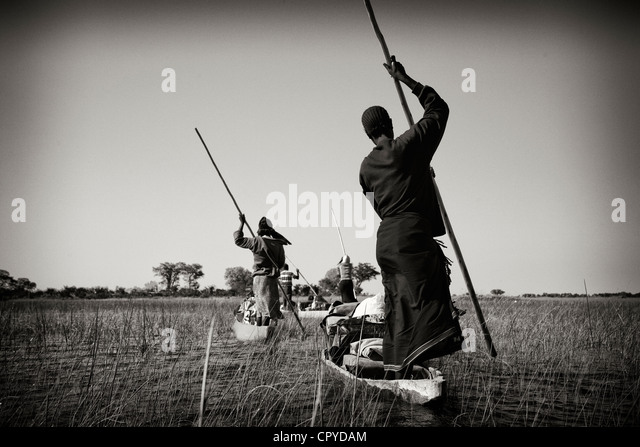 Bushmen punting boats in the Okavango Delta, Botswana - Stock Image