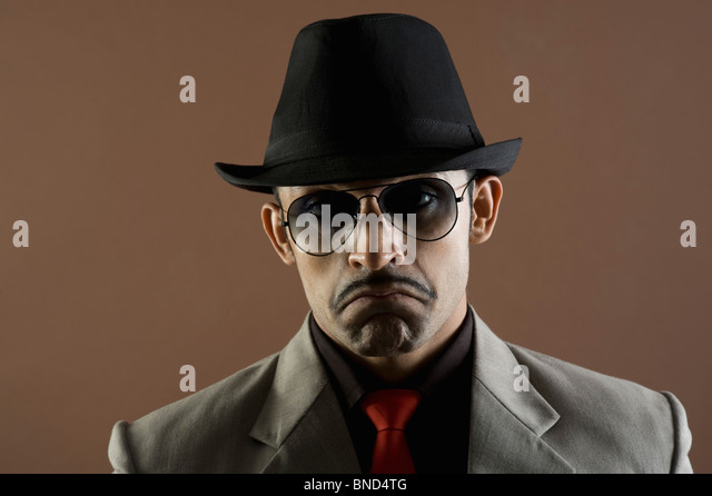 Close-up of an actor portraying a businessman sulking - Stock Image