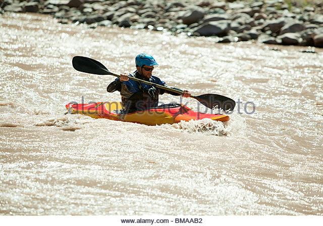 Man white water kayaking - Stock Image