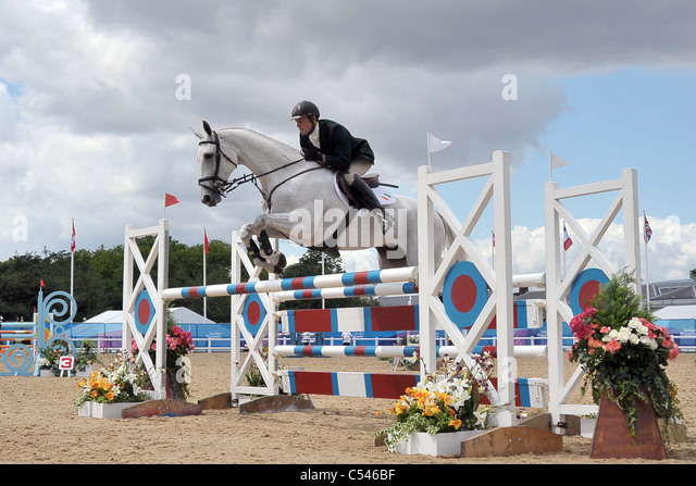 Joseph Murphy riding Chuckelberry (Ireland) jumps the last fence. Show Jumping Demonstration Competition. Greenwich - Stock Image