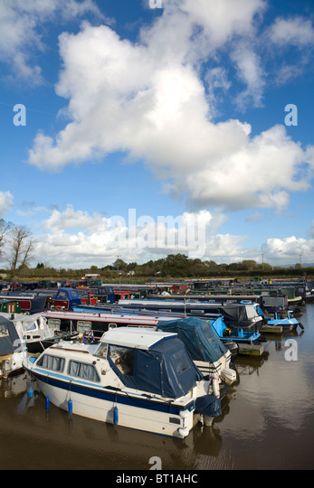 Canal barges moored in marina at Rufford, Lancashire - Stock Image
