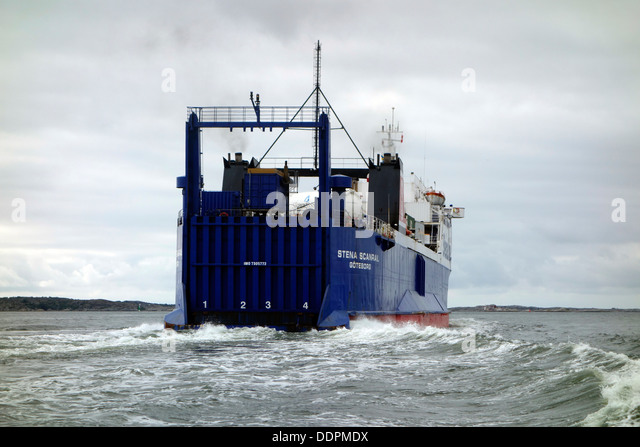 Ship sailing away. RoRo liner Stena Scanrail leaving Gothenbur on the way to Denmark. - Stock Image