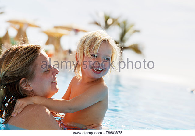 Spain, Gran Canaria, Maspalomas, Mother and son (2-3) in swimming pool - Stock Image