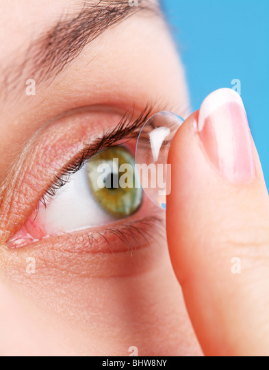 human eye with corrective lens on a blue - Stock Image