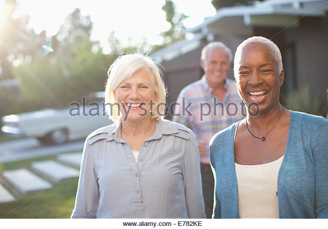 Three mature adults - Stock Image
