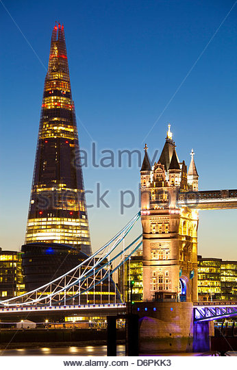The Shard building and Tower Bridge at Night, London, United Kingdom.  The Shard is the tallest building in Europe - Stock Image