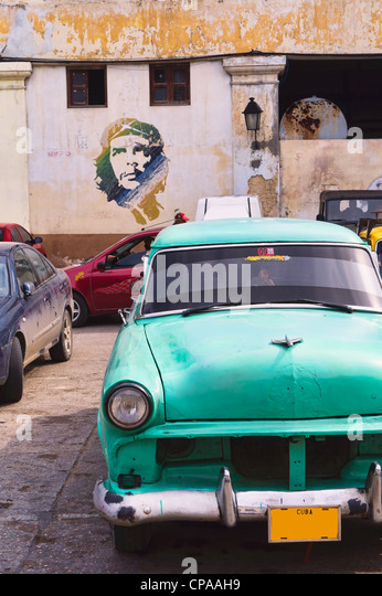 Havana, Cuba. Street scene with old car and worn out buildings. - Stock Image