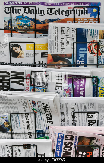 Newspaper rack, foreign-language newspapers - Stock Image