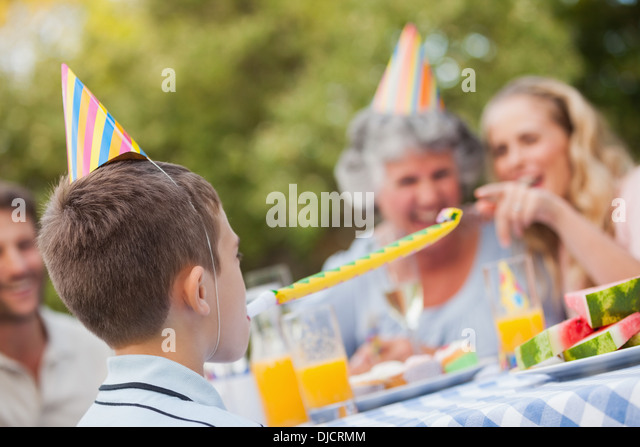 Cheerful son celebrating his birthday with his family - Stock-Bilder