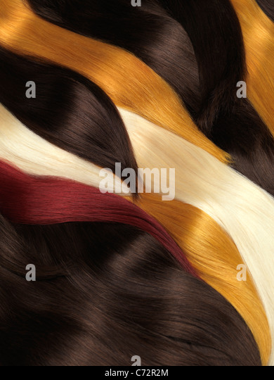 Natural human hair extensions of different colors - Stock Image
