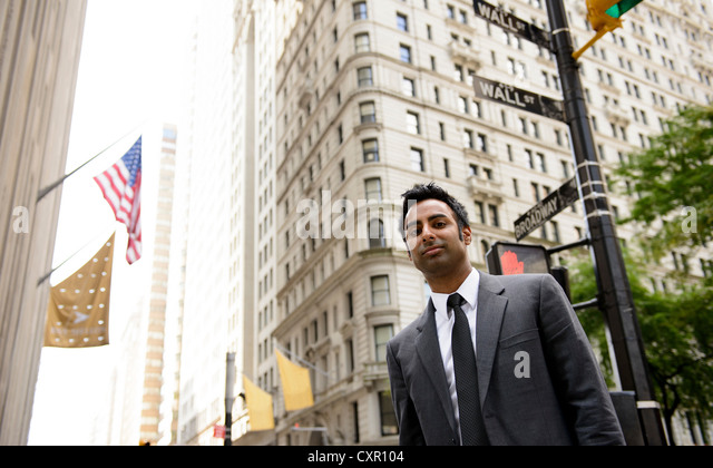 Businessman on Wall Street, New York City - Stock Image