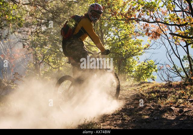 Italy, Southern Tyrol, man mountain biking - Stock Image