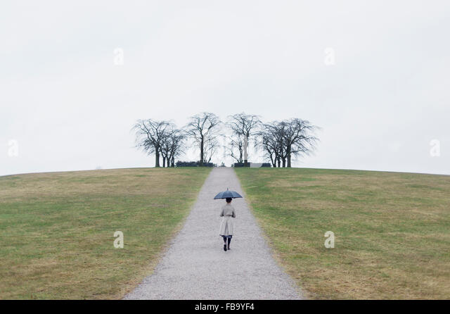 Sweden, Sodermanland, Stockholm, Skogskyrkogarden, Woman at Woodland Cemetery - Stock Image
