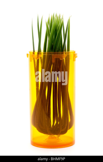 Grass in a pill bottle: alternative medicine - Stock Image