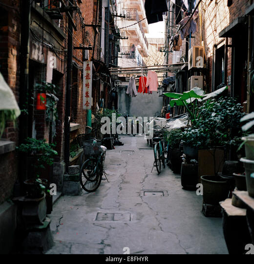 China, Shanghai, Narrow street - Stock Image