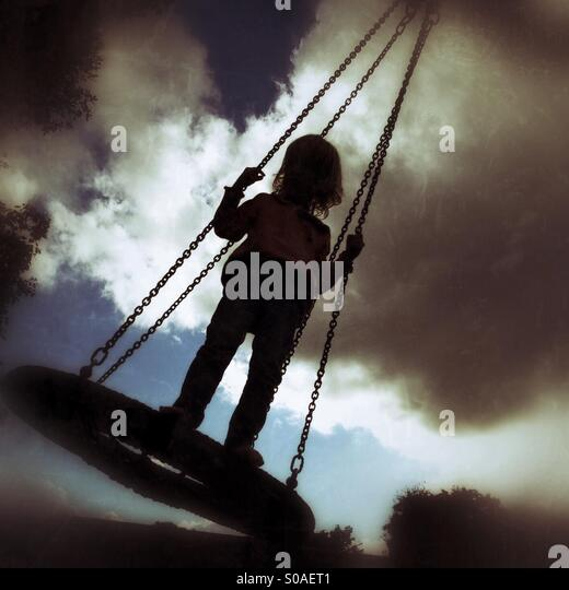 Child on a swing - Stock-Bilder