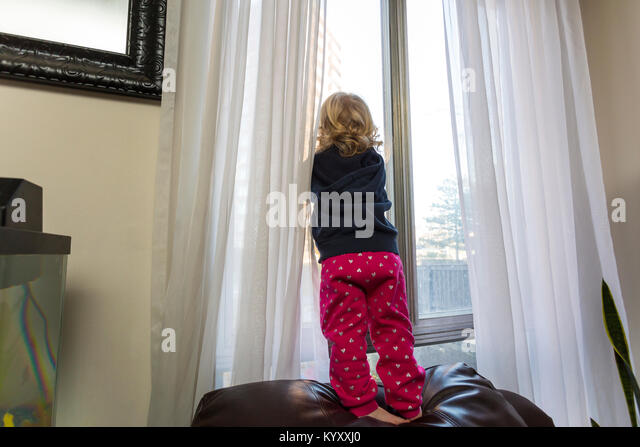 Climbing out window stock photos climbing out window for 2 year old falls out of window