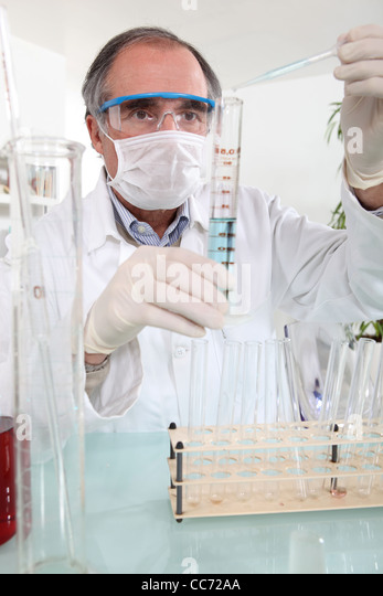 Male chemist in lab - Stock Image