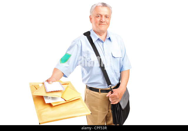 A smiling postman delivering mail isolated against white background - Stock Image