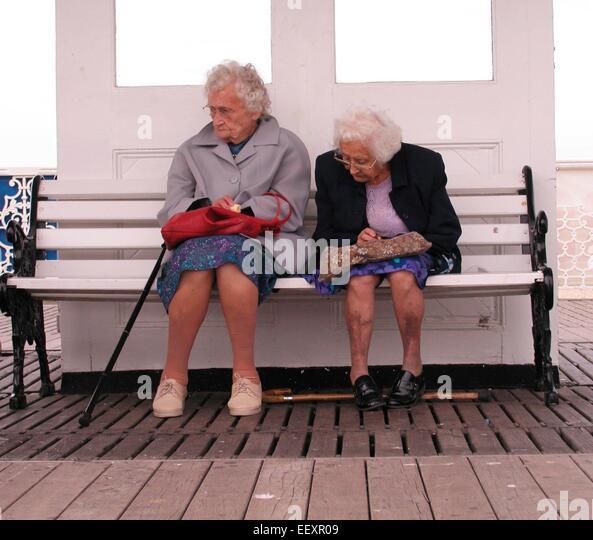 Elderly senior old age Pensioners  on Brighton pier - Stock-Bilder