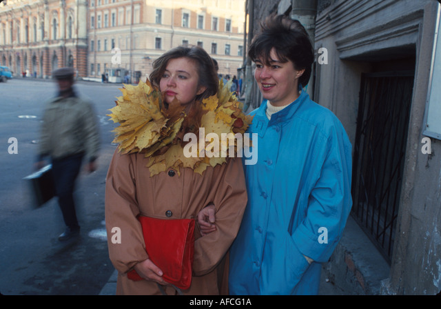 Russia former Soviet Union St. Petersburg residents one wears necklace of leaves - Stock Image