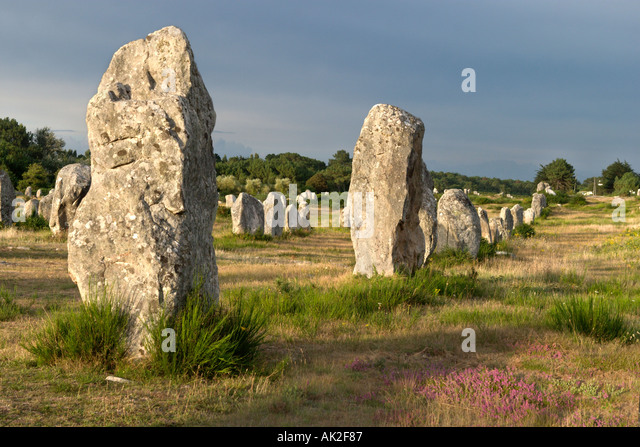 Megaliths in the late afternoon just before a storm, Alignements de Kermario, Carnac, Brittany, France - Stock Image