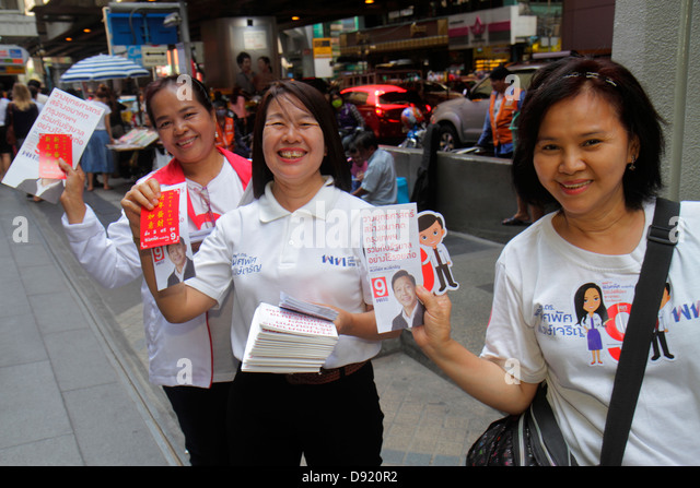 Bangkok Thailand Silom Silom Road Asian woman offering literature information health care services - Stock Image
