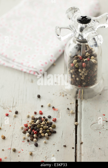 Mixed Peppercorns in Pepper Mill - Stock Image