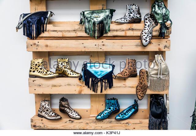 Lisbon Portugal 39a Concept Store shopping retail urban fashion booties shoes handbags display sale - Stock Image