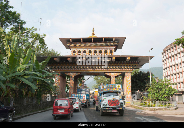 Traffic through Bhutan Gate, border, view from the Bhutan side, Jaigaon in India, Phuentsholing, Kingdom of Bhutan, - Stock Image