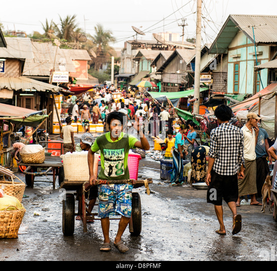Crowded with people street market Mandalay Burma Myanmar - Stock Image