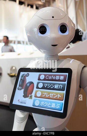 Tokyo, Japan. 11th July, 2015. The humanoid robot Pepper debuted as a new member of staff at the NESCAFE coffee - Stock Image