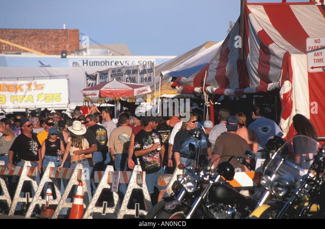 Daytona Beach Florida fl bike week crowds behind barricade on main street beer tents annual motorcycle party festival - Stock Image