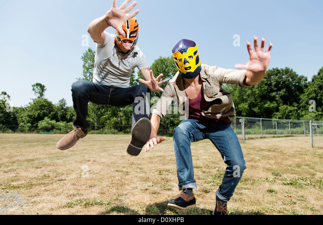 Two young men wearing wrestling masks - Stock Image