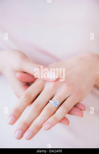 Woman hands with engagement ring - Stock-Bilder